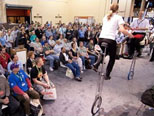 Trade Show Jugglers Scott Meltzer and Katrine Spang-Hanssen on six foot unicycles for HP
